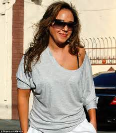 flashdance leah remini bares a shoulder in loose grey sweatshirt as leah remini bares a sexy shoulder in loose grey sweatshirt