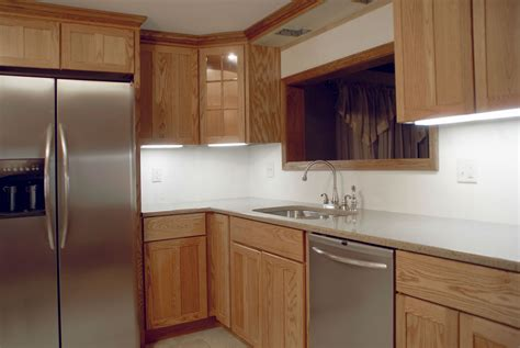 wall of kitchen cabinets refacing or replacing kitchen cabinets