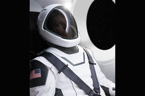 elon musk space elon musk shows off first photo of spacex space suit new