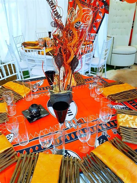 Orange and black Swazi traditional wedding decor at Shonga