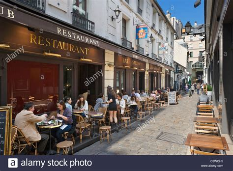 Sidewalk restaurant on the Cour du Commerce St Andre off the Rue St Stock Photo, Royalty Free