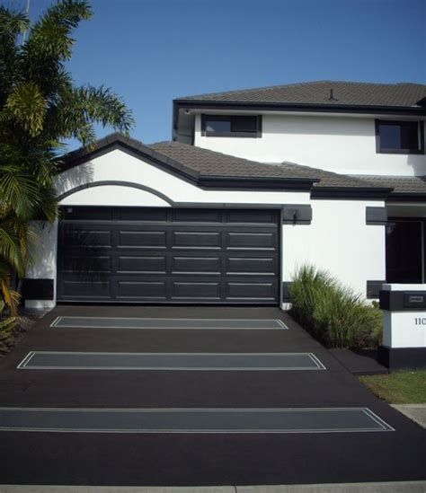 black and grey house concrete driveway black and grey matching white house with black roof caboolture