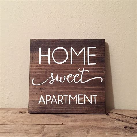 bild quot one bedroom apartment living room quot zu doubletree by home sweet apartment wood sign apartment decor by wiscofarms