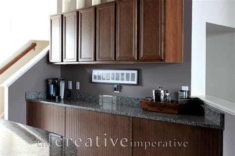 gray walls with cherry cabinets brown hairs