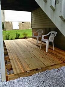 building a ground level deck diy ground level deck update aprons and stilletos