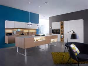 white and blonde wood kitchen blue feature wall interior design ideas