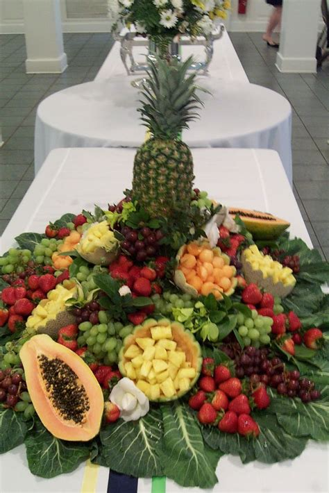 centerpieces using fruit and vegetables fill fruit bowls