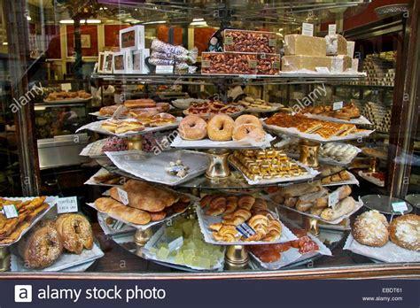 Spains Patisserie by Cakes In A Patisserie Shop Window In Madrid Spain Stock