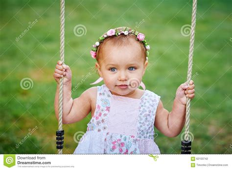 swing swing swing on a summer day adorable girl having fun on a swing on summer day stock