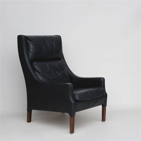 stylish black leather armchair by rud thygesen
