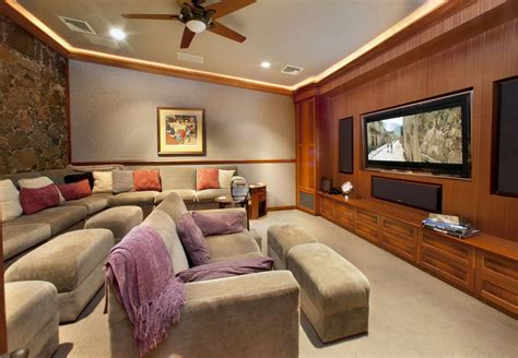 craftsman home theater with crown molding carpet in st