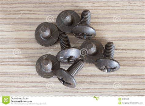 wooden bench screw old used screws on a wooden bench stock photo image