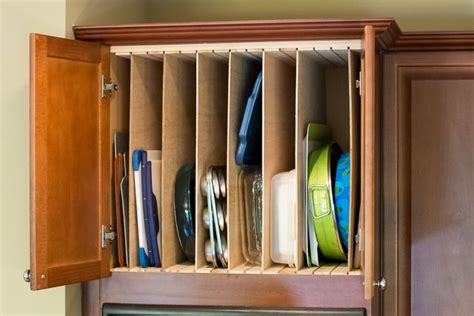 above kitchen cabinet storage ideas kitchen diy adding cookie sheet tray storage above the