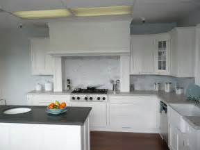 Use dark flooring with white kitchen cabinets with white appliances to