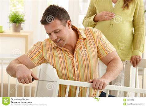 in daddys bed dad fixing baby s bed royalty free stock photo image