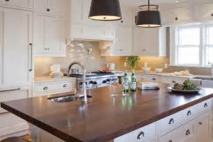 Attractive Tile Topped Kitchen Tables #8: White-kitchen-island-dark-butcher-block-counter-gray-glass-tile-backsplash.jpg
