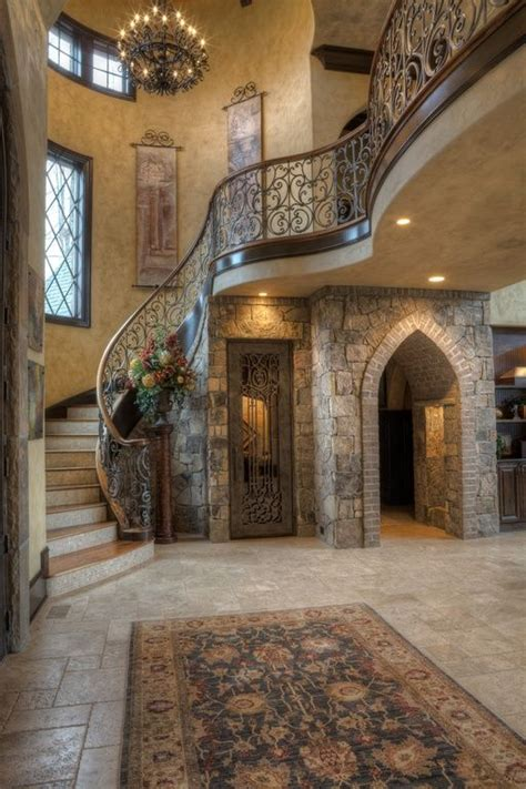 mediterranean entryway with exposed beam hanging tapestry
