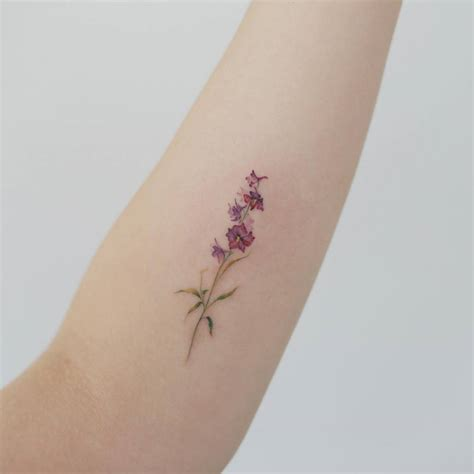 small art tattoo designs flower on the inner forearm artist doy