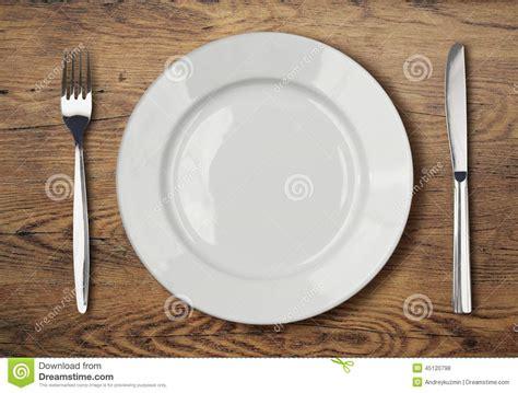 dinner setting white empty dinner plate setting on wooden table stock