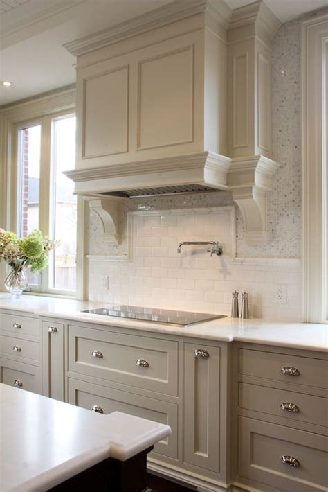 light gray kitchen cabinets paired with honed marble