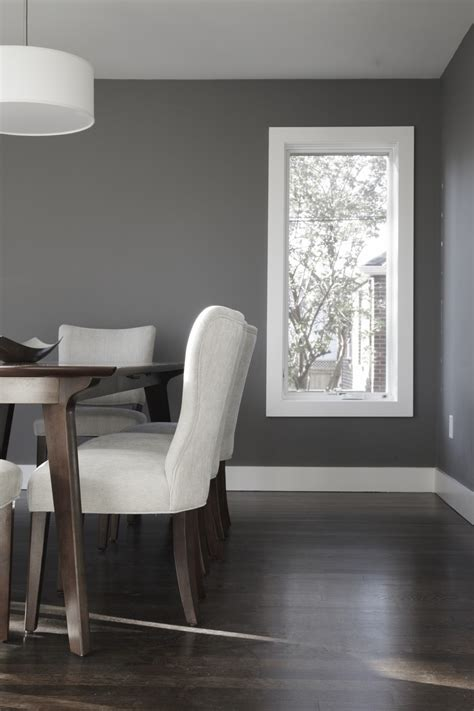 dark wood floors with light gray walls and white trim 360 winnett house by altius architecture