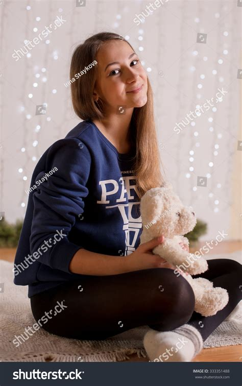 young little girls socks beautiful young girl in a sweatshirt and tights near the