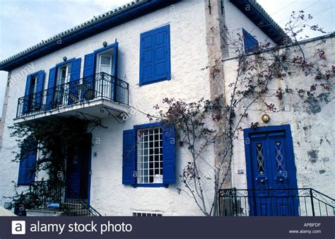 white house with blue shutters white house with blue shutters stock photo royalty free image 1490910 alamy