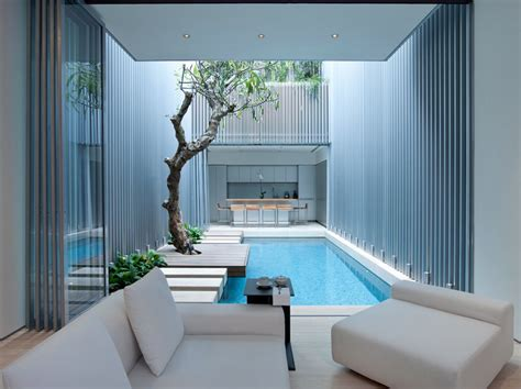 indoor design swimming pool in interior courtyard singapore interior design mag