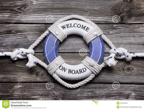 Wooden background with blue and white life preserver for maritim stock photo image 41076184