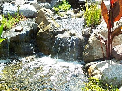 build a backyard waterfall and stream build a disappearing waterfall pondless waterfalls