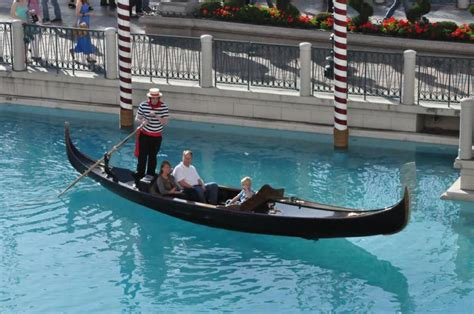 gondola boat vegas some tourists waving at vegas bob from a gondola boat at
