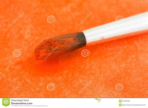 orange watercolor paint on bristles stock photo image 54457654