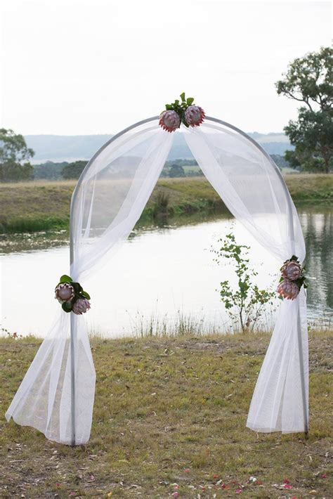 Gorgeous ceremony Arch decorated with tulle and King