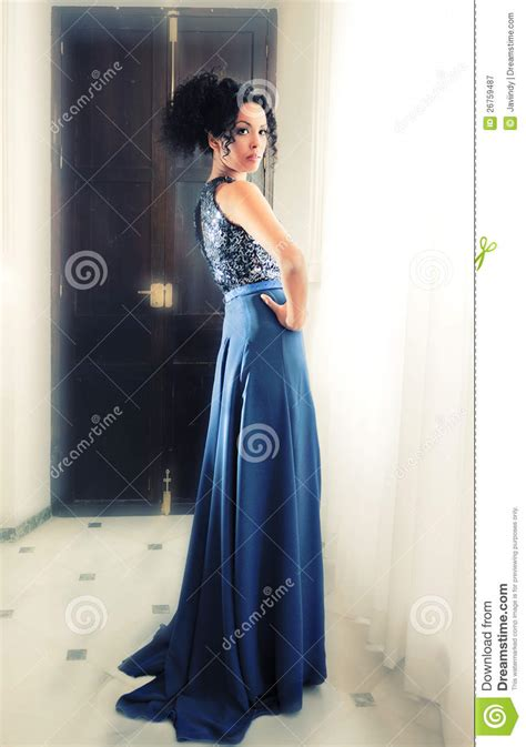 name of black women in blue dress in viagra commercial afro hair woman model of fashion with blue dress stock