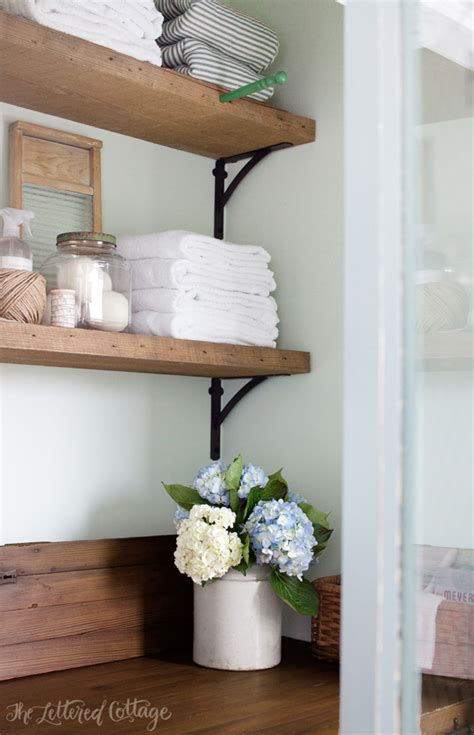 laundry room shelves laundry room countertop and reclaimed wood shelves the