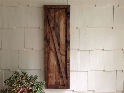 hanging a barn door barn door wall hanging rustic barn door decor hanging