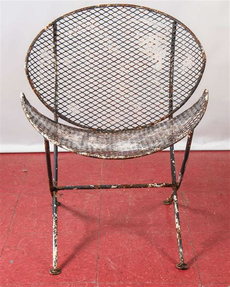 pair of mesh metal saucer outdoor chairs at 1stdibs
