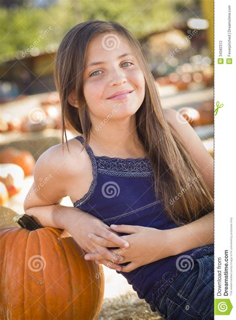 cute preteen cute preteen girl portrait at the pumpkin patch stock