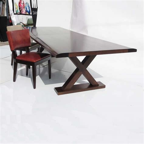 christian liaigre dining table with ten chairs at