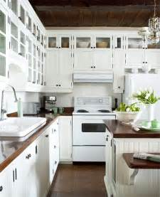 white kitchen cabinets with butcher block countertops