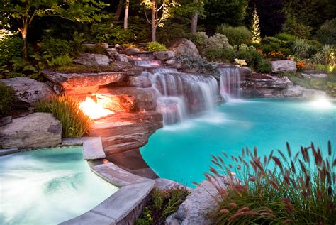 pools with waterfalls japanese natural swimming pool design with a stone fire
