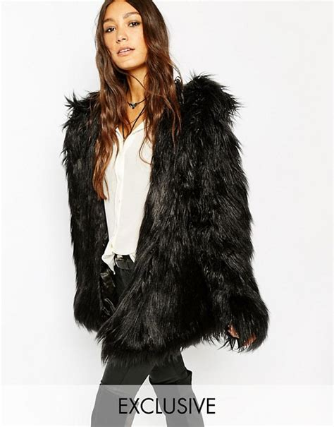 The Other Side Of The Fur Story The Luxurious Necessity by Story Of Lola Story Of Lola Hooded Fluffy Faux Fur Coat