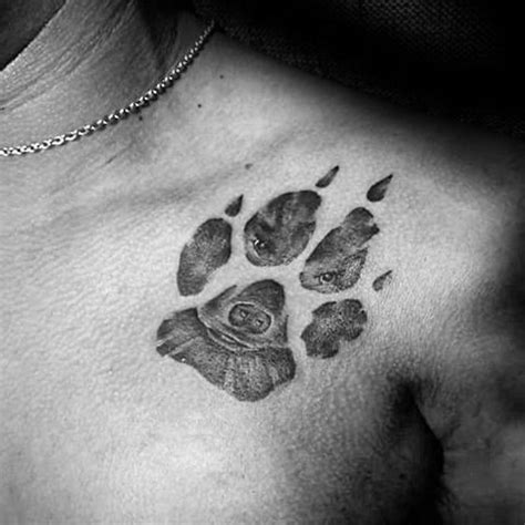 paw print tattoo on chest celebrity engraving style black ink shoulder tattoo of paw print