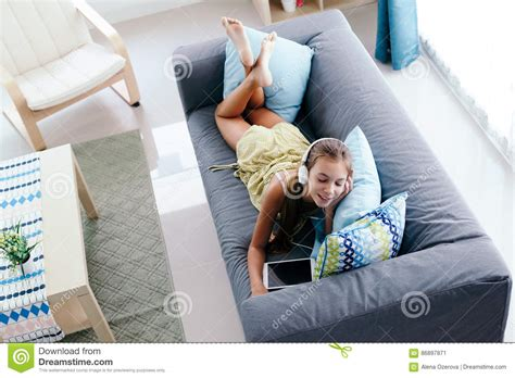 girl on the couch tween girl relaxing on couch at home stock image image
