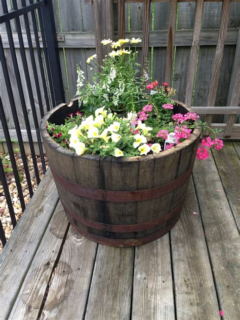 Whiskey Barrel Planter Ideas by Whiskey Barrel Planter Awesome Decorating Designs By