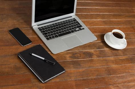 laptop office desk office desk with laptop notepad and cup of coffee photo