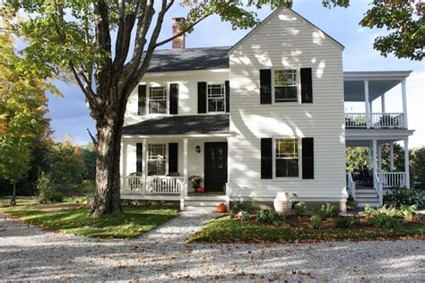 two farmhouse two farmhouse with a wrap around porch
