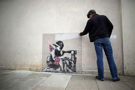 londons latest banksy graffiti artists  work