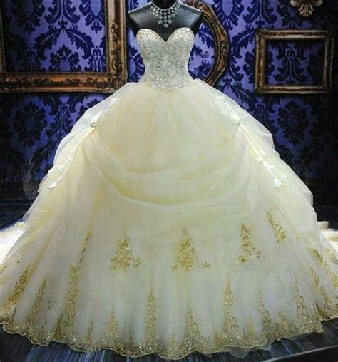 beautiful stunning wedding gown with a gold