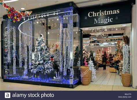 stores that sell christmas trees store in shopping mall selling trees and decorations stock photo royalty free image